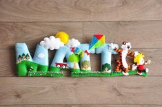 Customized wall decor, name banners, baby mobiles and ornaments. Each items are done handmade and every details are invested with much, love, care and time. Baby Name Banners, Felt Name Banner, Felt Letters, Animal Letters, Felt Garland, Felt Baby, Calvin And Hobbes, Felt Toys, Felt Animals