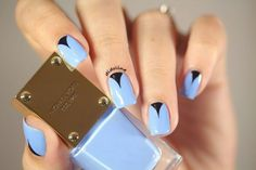 Blue and black triangle moon nail art