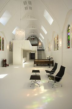 This space has a beautiful Church feel. I would remove that style chairs and use benches or pews maybe. Would make a great meditation/sanctuary/worship space.