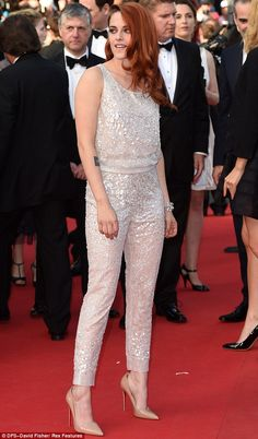 Cannes 2014.  She sparkles: Kristen shimmered in a top and trouser set sewn with thousands of sequins at the Cannes Film Festival premiere of Clouds Of Sils Maria