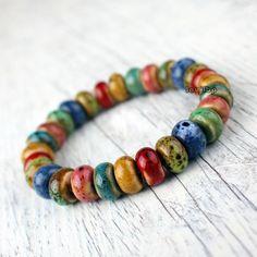 Beautiful colorful ceramic jewellery bracelet hand