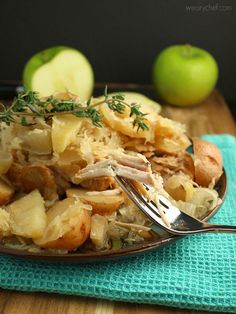 Get ready for a deliciously easy take on Slow Cooker Pork Chops with Sauerkraut, a traditional Amish New Year's meal!