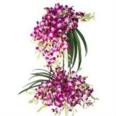 2 Tier 50 Purple Orchids Design Arrangement. Buy this at Rs.3,499.00.