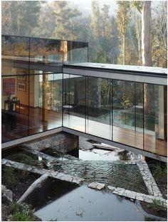 Glass hallway/walkway/bridge.  View of nature.