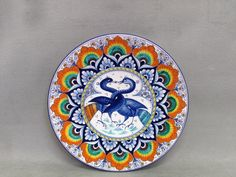 "Artistic ceramic plate decorated by hand in Pavona and Persian Palmette styles, with in the center two birds called ""astorre"" with intertwined necks. Ceramic Plates, Decorative Plates, Bird Calls, Two Birds, Persian, Ceramics, Style, Pottery Plates, Ceramica"