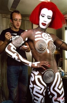 Keith Haring paints live canvas Grace Jones for a music video. Another time for a movie character named Katrina in the movie Vamp.