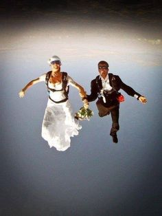What a way to start your new life together. Been married almost 30 years and many times I feel like these two :) Bungee Jumping, Base Jumping, Tandem Jump, Wingsuit Flying, Paragliding, Funny Tattoos, Iconic Photos, Snow Skiing, Architecture Design