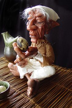 This little guy sits 9 inches tall, cross legged, his hands, feet and face are sculpted in polymer clay.