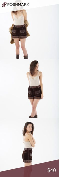 """V I N T A G E brown leather shorts Vintage 1970s brown leather shorts. Genuine leather & suede, high waist, two front patch pockets. Made in Mexico. Excellent vintage condition. No size marked; best fits a SM. Waist 26"""", hips 34"""", length 13.25"""", inseam 4"""", rise 10.5"""". PLEASE REFER TO MEASUREMENTS FOR FIT. Vintage  Shorts"""