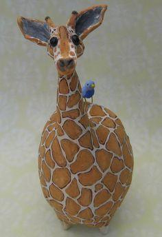 ceramic giraffe sculpture