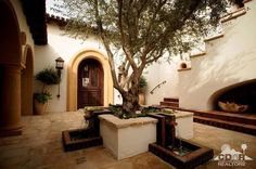 Exterior old world details: arches, stone, wrought iron, columns, tile, earth tones