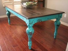 Antique Table...love the turquoise legs