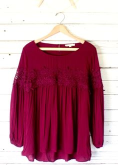 Super cute flowing top with long sleeve with 4 1/2 inch lace inset across the bust and extends across the sleeve.  Available in two colors!     Imported  Rayon  21 inch bust and 26 inches long (taken from size small, add 1/2 inch for next size up).
