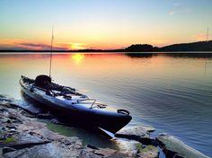 Kayak fishing on lake Jukajärvi, Finland