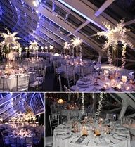 """Kehoe Design's dramatic white """"starburst"""" centerpieces were a perfect fit for this celestial wedding at the Adler Planetarium. KehoeDesigns.com"""