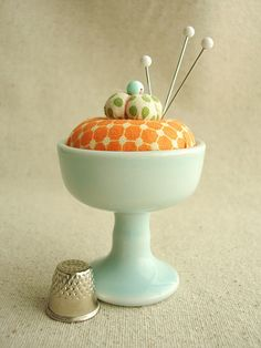 sweet little pin cushion..giving me a great idea for my unused egg cups!!