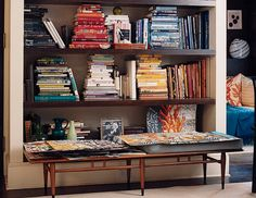 Not all books need to be standing up. Stacking is an intentional move. Stacking by color is a powerful styling move.