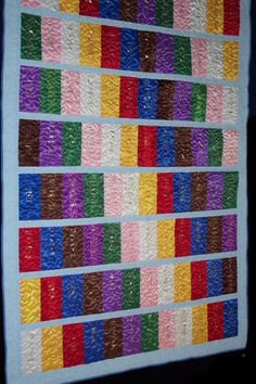 """ribbon quilt. Great site with many different types of ribbons and designs in  quilts. For all you JH and HS track stars, here's your answer to """"What do I do with all my ribbons?"""""""