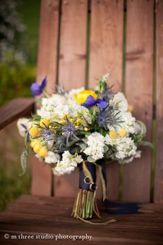 Steph's bouquet - blue anemone and thistle, yellow billy balls and ranunculus, white stock