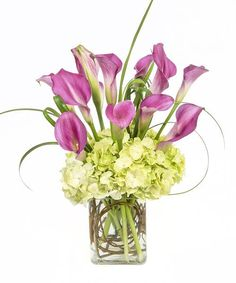 07d4c3aeea4d Featuring miniature calla lilies and lime green hydrangea gathered in a glass  vase with curly willow