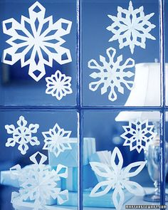 Have the guests cut out their own snowflakes, then when finished, hang all the snowflakes up from the ceiling and around the windows, and create my own snow (that I wish for every year, but never get)!