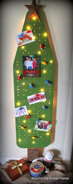 Refurbished & reclaimed ironing board turned into a fabulous Christmas Tree!! ~ I adore this!! ~ Using the vintage Snoopy lights with magnets attached to the back, adding a wooden tree trunk, & being able to have a unique display for those pretty Christmas cards & pictures! ~ WIN! WIN! ~ ♥
