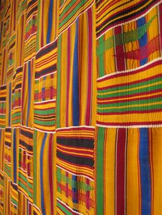 This vintage Kente is a ceremonial cloth handwoven on a horizontal treadle loom. The stripes are sewn together into larger pieces, taking anywhere from several weeks to several months for a weaver to