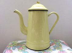 With its buttery yellow enamel, this is a typical French coffee pot of the type that was used in many a country farmhouse for generations.  In relatively good condition given its age, this would look lovely on an Aga or displayed with flowers or utensils in your kitchen.  I am listing a few of these (in cream and in red & white check), so keep an eye out for the other postings as these look really fantastic when grouped together in threes or fours. I am happy to do combined postage.  Dime...
