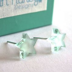 Frosted Twinkling Star Earrings by Sarah Hurley, the perfect gift for Explore more unique gifts in our curated marketplace. Twinkle Star, Twinkle Twinkle, Cardboard Jewelry Boxes, My Signature, Star Earrings, Jewelry Shop, Jewellery Box, Ear Piercings, Frost