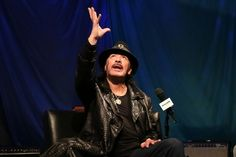 You have to reach out and grab it. Carlos Santana goes for it during a visit to SiriusXM Studios on Oct. 14 in Washington, D.C.
