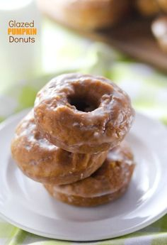 Enjoy hot, fresh Glazed Pumpkin Donuts at home with this simple baked recipe!
