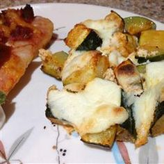 Zucchini and Ricotta Casserole. I like the idea of roasting it in a very hot oven so the zucchini doesn't turn soupy.