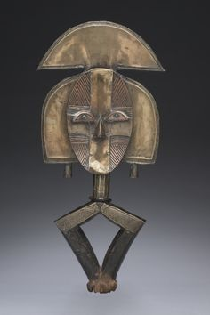 Reliquary Guardian Figure, probably 1800s                                                Equatorial Africa, Gabon, Kota , probably 19th century