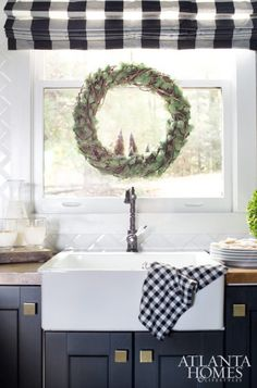A woven vine-and-moss wreath adds natural appeal to the newly renovated kitchen.