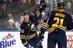 Dec 16, 2016; Buffalo, NY, USA; Buffalo Sabres defenseman Rasmus Ristolainen (55) celebrates after scoring the winning goal in overtime against the New York Islanders as right wing Kyle Okposo (21) looks on at KeyBank Center. Sabres beat the Islanders 3-2 in overtime. Mandatory Credit: Kevin Hoffman-USA TODAY Sports