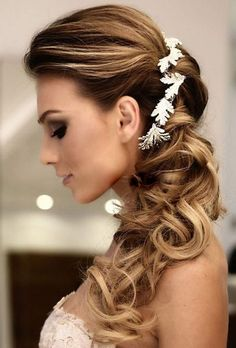 side ponytail wedding hairstyles wih white floral hairpiece