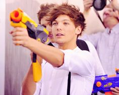 SO CUTE. the only people that can make nerf guns look hot instead of immature.