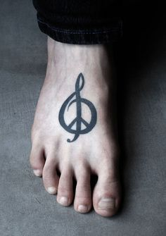 Clef peace symbol tattoo Clef Peace Symbol Tattoo. LIke the tat just not the placement.