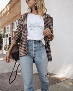 Worn in classic jeans with a graphic tee and houndstooth blazer. Not a fan of this text on shirt.