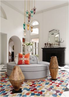 In Good Taste: Julia Buckingham - Design Chic- love the wood decorative objects in the living room