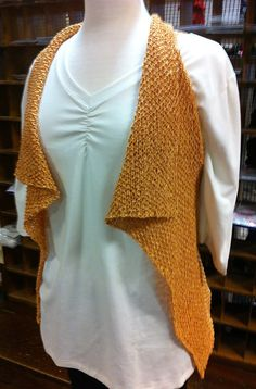 Free Knitting Pattern for Seabrook Vest - This draped vest by Amanda Keep Williams is super easy. Just knit a single rectangle with armholdes in seed stitch at a loose gauge and it drapes naturally. Pictured project by lippyone