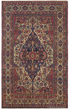 Laver Kirman, 4ft 5in x 7ft 1in, Circa 1850. The very significant age of this collectible antique Persian Laver Kirman rug is revealed in the artistic ability to render a symmetrical design with the vibrancy of a garden in bloom. This is partially accomplished through minute inconsistencies between mirrored motifs and the depiction of myriad blossoms tilted at many different angles.
