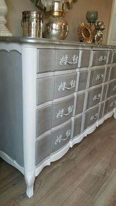 """Side view of the Upcycled vintage French Provisional wavy drawer dresser used as a buffet. Silver metallic top, white, gray chalk paint then on the sides gray washed and distressed. The knobs were layered in Rustoleum spray paint. I added a bit of shimmer on the drawers for a little extra """"bling"""". Love the end result. You can see more on my FB page ChicandShabbyFurnitureByRebecca Painting Old Furniture, Baby Furniture, Metal Furniture, Upcycled Furniture, Furniture Projects, Furniture Makeover, Vintage Furniture, Furniture Decor, Painted Furniture"""
