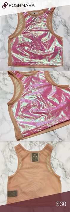 UNIF Plur Pink Holographic Crop Top UNIF Plur Pink Holographic Crop Top  Size Extra Small. Never worn, in great condition. This cropped top comes in a fitted silhouette with holographic foil paneling on the front, stitched piping along the scoop neckline, and mesh sheet back.  Feel free to make an offer  UNIF Tops Crop Tops