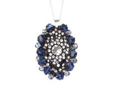 This pendant is made of rhodium plated metal, studded with Swarovski ® Elements in shades like Saphire, Alexandrite, Jet, Silk and Crystal set in Ceralun™ (high-performance ceramic epoxy composite developed for the application of Swarovski Elements®). The Saphire pendant has a Sterling Silver 925% chain and is 100% Nickel Free, Lead Free and Cadmium Free. Approximate pendant length 45mm, chain length 50cm.
