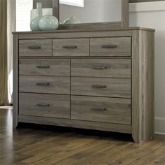 Lowest price online on all Ashley Zelen 7 Drawer Wood Double Dresser in Brown - B248-31