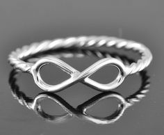 infinity ring, twisted ring, sterling silver ring, promise ring, infinity knot ring, personalized ring, friendship, wedding band. $40.00, via Etsy.