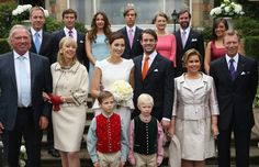 Snapshot as the royals join Claire's family for a group photo with the bride and groom