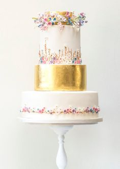Mixing florals and gold leaf in this midsummer night's dream #weddingcake by Rosalind Miller