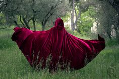 This amazing cloack was designed for Red Riding Hood. Is made in red velvet It has a beautiful hood and is laced on the front.   Beautiful, beautiful